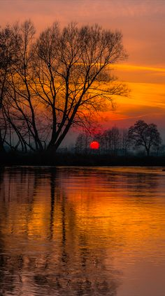 Sunset on the Wieprz river in Bykowszczyzna, eastern Poland • photo: Piotr Fil on Flickr
