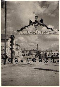 """6.1941 - Lwów, Poland: """"Glory to Hitler, glory to Bandera!"""" A welcome sign to the entering German and  Organization of Ukrainian Nationalists (OUN) troops. Stepan Bandera (1909-1959) was a Ukrainian politician and one of the leaders in Western Ukraine (Galicia), who headed the OUN. He was responsible for the proclamation of an Independent Ukrainian State in Lwów on 6.30.1941, eight days after Germany's attack against the USSR."""