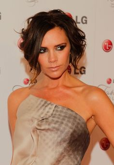 Pin for Later: Victoria Beckham's Hair Can't Be 40 (It Looks Too Good) 2010 The bob was back by 2010. Victoria wore curly tendrils framing her face at the Night of Fashion & Technology event for LG.