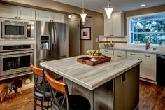 Bothell Kitchen Remodel from Provanti Designs, Inc Kitchen & Bath Designers featuring a Formica 180fx® Travertine Silver island