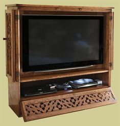 hand carved oak tv cabinet shown in fully open access mode to load dvd