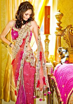 Fuchsia pink and gold lehenga, with a net dupatta. Make your mark at the wedding!