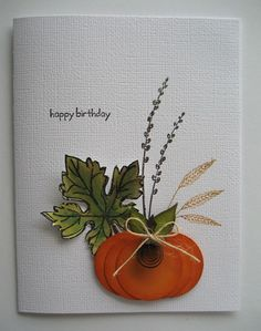 handmade card ... Autumn theme ... lots of white space ... luv the pumpkin made from punched circles with sponging for depth ... montage with stamped wheat and pussy willows , stamped and fussy cut maple leaf, the pumpkin, a button and a twine bow ... Stampin' Up!
