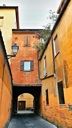Twitter / @melvin: A colorful back street in beautiful Bologna, Emilia Romagna, Italy. Like it?