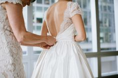 Classic lace wedding dress style: http://www.stylemepretty.com/massachusetts-weddings/boston/2016/02/10/classic-state-room-wedding-with-vintage-nautical-touches/ | Photography: Lauren Methia - http://laurenmethia.com/#!/HOME
