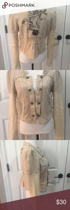 EUC Free People Embroidered Cardigan Excellent used condition. Perfect to wear over a tank or fitted top. Beautiful details include non-functional distressed buttons, 2 hooks for closure, two tone sleeves, distressed embroidery on the back. Waist length.  100% Wool  No trading. Free People Sweaters Cardigans