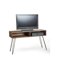 The Eastwood media console features a sleek mid century modern design with some rustic elements added in. The natural finished reclaimed fir adds character and history to the TV stand.