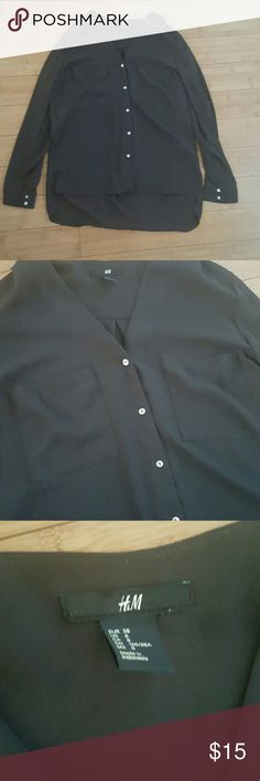 H&M high low button down Dark gray, 2 front breast pockets, button down. Has buttons on sleeves to be rolled up. As seen in pic 4, it is high low. TTS 8/medium H&M Tops Button Down Shirts
