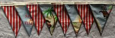 Tris: Pirate flags: An idea for Buddie's room window treatment - easy for me to make.