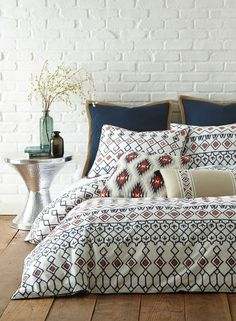 Absolutely adoring this bold geometric print bedding in bright hues for a modern-boho look.