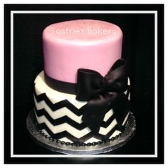 Pink, black and white chevron print birthday cake with a large black fondant bow! #tastriesbakery