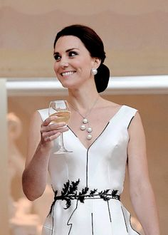 """catherine-middleton:  """" The Duchess of Cambridge wore a black and white ensemble with a plunging neckline, adorned with asymmetric black piping and topped off with an old pearl necklace and her trusty Gianvito Rossi pumps, for the garden party in..."""