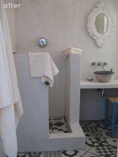 divisória de alvenaria, ladrilhos hidráulicos, espelho branco