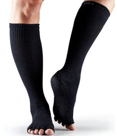 ToeSox Scrunch Socks: Cozy ToeSox Knee-High Scrunch Socks ($16) are a perfect gift for any barre buff. The no-slip sole offers secure placement on any surface.