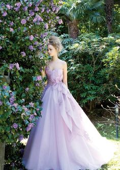 8. Lilac Petal Dress (price upon request): Let love blossom at a springtime garden wedding by stepping out in a lilac, petal-inspired Jillian gown that's fit for the modern fairy princess. | 18 Colorful Wedding Dresses for the Non-Traditional Bride | Brit + Co