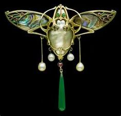 designed by EMIL RIESTER, Dramatic Jugendstil Brooch of gilded silver w/ abalone wings, chalcedony, garnet, green & red glass & natural pearls German. Circa 1905.  Riester died 1925, a goldsmith, designer, painter, & teacher, professor of Jewelry at the Pforsheim Kunstgewerbe School from c 1877