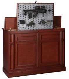 Custom cabinetry with hidden & Secure Weapons Storage. Electrically drives the weapons from concealment to fully raised in 9 seconds.