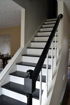 stairs - open on one side. this is what ours will look like when we open up the wall next to the dining room!