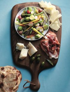 How to make an antipasto charcuterie platter. A shared platter of freshly pickled veggies and other nibbles is a new take on a vintage crowd pleaser. Photo by Roberto Caruso