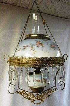 Amazing Antique Porcelain Hanging Oil Parlor Lamp.  Lamps such as these were made by companies like Bradley Hubbard starting mid-nineteenth century to mid-twentieth century.  A beautiful display piece for any room you choose to hang it in.  The basin has been broken, and though you can not see it when it is in its base it renders it inoperable for use as originally intended.