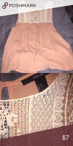 Forever 21 peach tank with front lace detail Peach flowing tank top with lace crochet detail on front top portion. Great condition. Forever 21 Tops Tank Tops