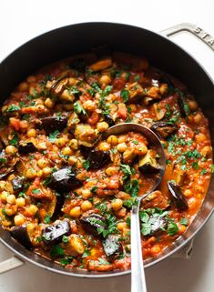 Braised harissa eggplant with chickpeas is an easy vegan and gluten-free main course. Meaty eggplant, spicy tomato-y broth, and protein-rich chickpeas. Added artichokes and eggs and didn't use broth. Chickpea Recipes, Vegetable Recipes, Healthy Recipes, Free Recipes, Veggie Dishes, Vegan Recipes Vegetables, Egg Plant Recipes Easy, Tasty Dishes, Vegan Bean Recipes