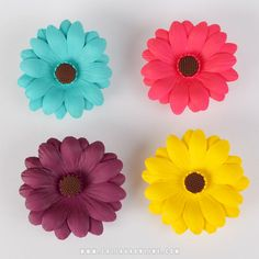 Colored Gumpaste Daisy sugarflower cake decorations perfect for cake decorating rolled fondant wedding cakes and rolled fondant birthday cakes and cupcakes.  | www.CaljavaOnline.com #caljava #sugarflower