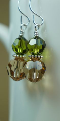 Handmade green and amber Swarovski crystal earrings with sterling silver wire wrapping and ear wires. $34  https://www.etsy.com/listing/195892588/green-and-amber-swarovski-crystal