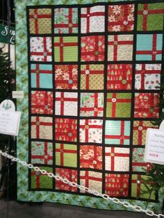 This is the coolest Christmas quilt ever! Love the colors and the detailed fabric covered buttons on the packages. (Festival of Trees)