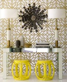 Bright yellow faux bamboo Asian garden stools and hthe gold metallic wallpaper. Mirrored console table with large brass lamps flanking a black sunburst mirror Yellow metallic entrance foyer Design Entrée, The Design Files, Design Blog, Deco Design, House Design, Foyer Design, Design Table, Design Hotel, Design Interiors