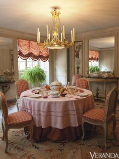 The dining room is centered by an ormolu and cut-crystal eight-branch chandelier from 1820 (estimate $9,400-$13,000). Christie's   - Veranda.com
