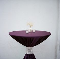 tie the cocktail table linens with black and white bows?