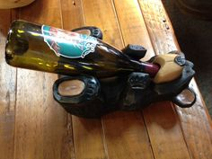This adorable bear wine holder adds a touch of whimsy to your wine decor. Doesnt have to just hold a bottle of wine though, any other bottle will fit as well!