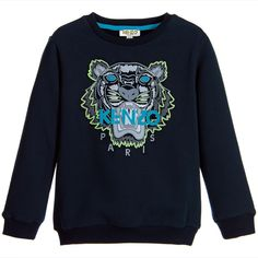 Boys navy blue sweatshirt by Kenzo, in the designer's 'Smiley in the Space' theme. It has a pale green, grey, white and pale blue roaring tiger's head printed on the front with the designer's pale blue logo appliqué across. Made in soft cotton jersey with a fleecy underside, it has a round, ribbed neck, cuffs and hemline. Would look cool with pale green or blue jeans.