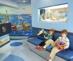Children's waiting room - mural, custom furniture and fish tank - Irvine, Mission Viejo Pediatric Dentists | Orange County