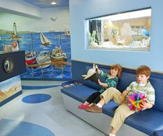Children's waiting room - mural, custom furniture and fish tank - Irvine, Mission Viejo Pediatric Dentists | Orange County