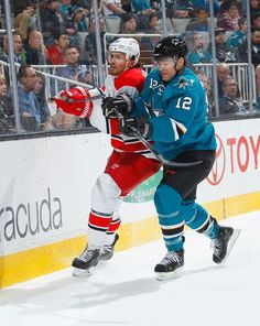 San Jose Sharks forward Patrick Marleau delivers a check to Ron Hainsey of the Carolina Hurricanes (Feb. 7, 2015).