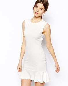 ASOS Sleeveless Peplum Hem Dress $38.00 (sale) this is the perfect summer dress for going out and I love the cut of this dress. I need to find a dress in my closet I can do this too.