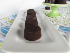 Irresistible Coconut Oil Chocolates    1/2 cup Tropical Traditions Coconut Oil      1/4 cup Cocoa Powder (raw cocoa powder is preferred)      2 Tbsp Organic Raw Honey (or sweetener of choice: maple, yacon powder, stevia), adjust according to taste      1 tsp vanilla extract (optional)