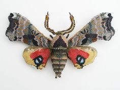 KAREN PAUST Sphinx Moth Brooch. Glass seed beads, wood, wire, nylon thread, sterling silver pin back.