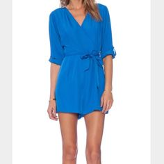 {Jack} Romper ~ Victoria blue The color of this romper is a bright blue. New with tags, never worn. Great details and super stylish. Does have s side zip, tie at waist and is fully lined. Jack by BB Dakota Other
