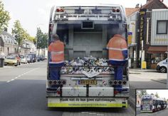 """This is the back of a city bus. but it's wrapped like the back of a garbage truck. Note for the passengers: """"Don't change the bus into  a garbage truck'"""