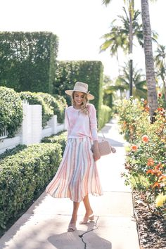 Little Blonde Book A Fashion Blog by Taylor Morgan: Palms and Stripes. White and pink palm print sweater+striped midi skirt+blush mules+nude chain shoulder bag+straw sun hat+sunglasses. Spring Casual Outfit 2017