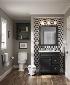 Giving your bathroom a facelift is as easy as a stylish new vanity with a coordinating mirror and a fresh light fixture. Take your bathroom project to the next level with a chic accent wall created with tile or wallpaper.