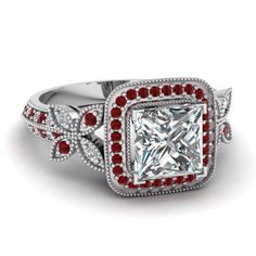 Image from http://cloudfiles.fascinatingdiamonds.com/white-gold-princess-white-diamond-engagement-wedding-ring-with-red-ruby-in-pave-set-FDENS3262PRRGRUDR-NL-WG.jpg.