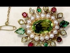 A stunning 4.35 carat peridot, 2.56 carat emerald and sapphire, seed pearl and 18 carat yellow gold brooch / pendant; part of our diverse antique jewellery collections