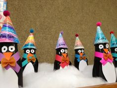 Penguin craft made with Starbucks frappuccino bottles and black paint in the inside. Children decorated own their penguins. Displayed on top of shelves in classroom and placed in fake snow