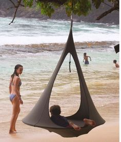 The New Songo Hanging Tent FREE SHIPPING The beautiful organic shape of the twin doors blend subtly with the oval base shape affording a more elongated shape better suited to a fully reclining occupan