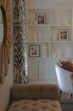 Nightingale Design: Gorgeous living room with light gray walls, floor to ceiling black and white ikat ...
