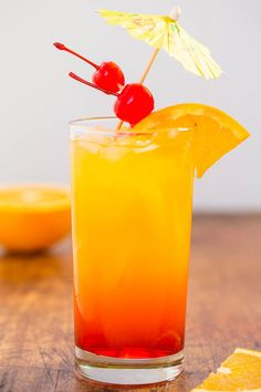 Tequila Sunrise - The classic cocktail that never goes out of style! Refreshing and easy! Everything tastes better topped with an umbrella!!